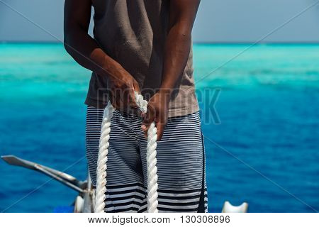 Black Hands Holding White Rope