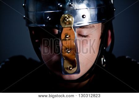 Young Boy Wearing Roman Soldier Helmet