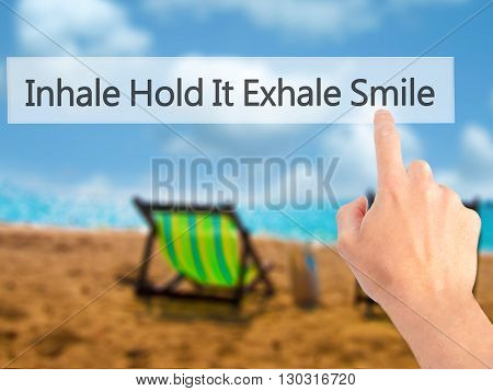 Inhale Hold It Exhale Smile  - Hand Pressing A Button On Blurred Background Concept On Visual Screen