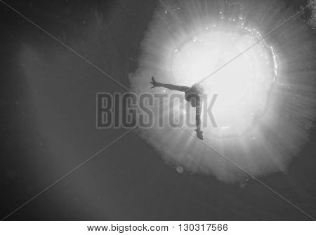 Backlight Diver Underwater Coming To The Deep Ocean