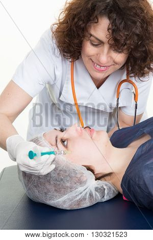 Woman is doing a cosmetic surgery injections