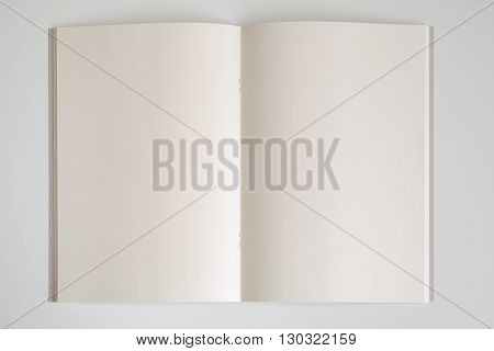 open vintage book on white background with copy space