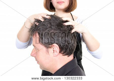 Man Getting A Massage While Having Hair Cut At Salon By Hairdresser