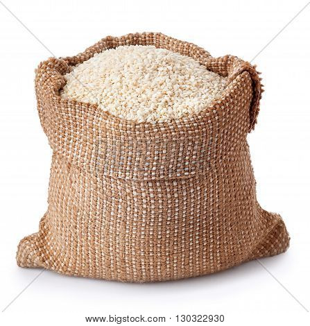 sesame seeds in sack isolated on white background. Full burlap bag with sesame seeds. Sesame seeds