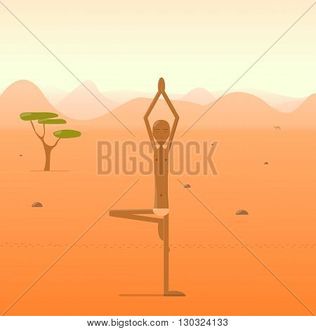 Yogi standing in the tree pose in the desert.