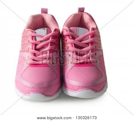 lovely tiny pink sneackers for little girl isolated on white background