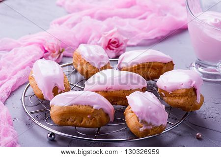 Homemade Strawberry Eclairs With Pink Cream On The Grey Table