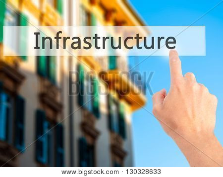 Infrastructure  - Hand Pressing A Button On Blurred Background Concept On Visual Screen.