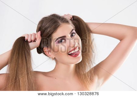 young woman with the put-out uvula. a horizontal portrait on a white background