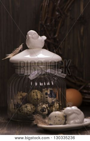 Glass jar with quail eggs. Easter greeting card. Spring concept.