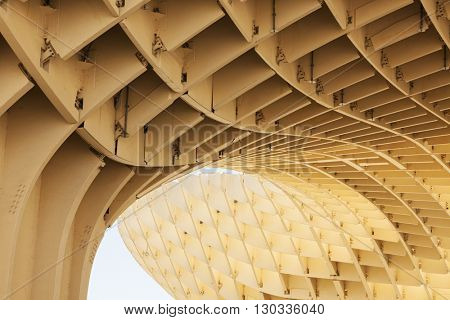 Seville, Spain - May 1, 2016: Detail view of the wooden construction the Metropol Parasol building is made of. It is the largest wooden structure in the world.
