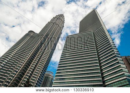KUALA LUMPUR, MALAYSIA - NOVEMBER 10: View on famous high-rise Petronas twin tower with bridge from below. November 2015