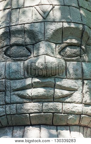 Maya Aztec style stone statue detail close up