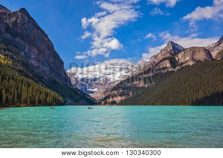 Banff National Park, Canada, Alberta. Magnificent Lake Louise with emerald green water surrounded by the Rocky Mountains and glaciers