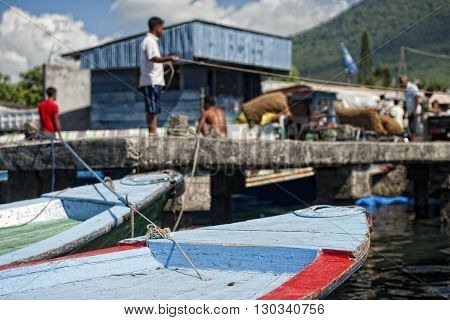Indonesian People Working In Harbor