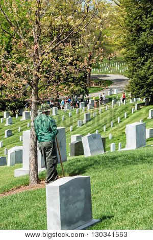 Washington D.c., Usa - May, 2 2014 - Worker Is Cleaning Tombstones At Arlington Cemetery