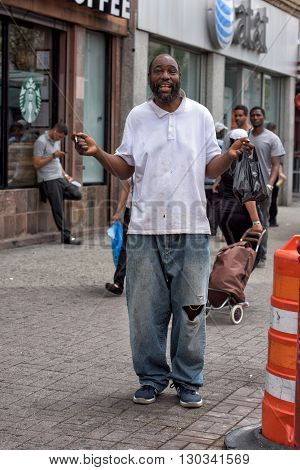 New York, Usa - June 15, 2015 - Homeless Smiling For The Camera In Harlem On Weekday