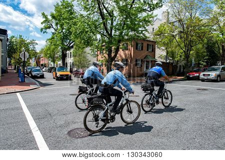 WASHINGTON D.C. USA - MAY 2 2014 - bicycle policemen in Georgetownon sunny day