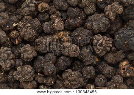 Organic Dried Cheese Fruit or Noni (Morinda citrifolia) seeds. Macro closeup background texture.