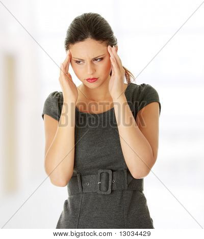 Young business woman with headache