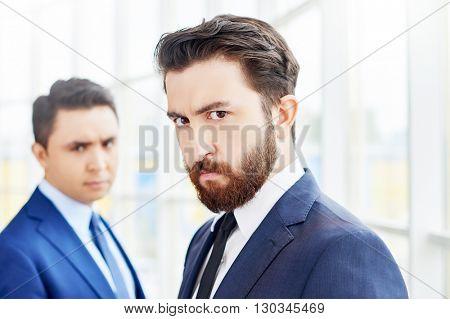 Portrait of sullen businessmen