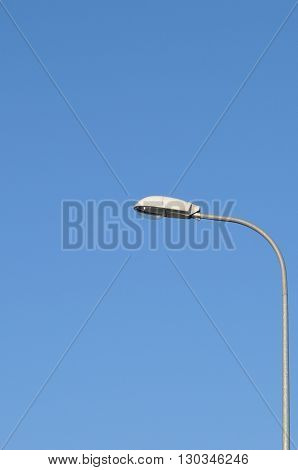 Lamp street lighting on the background of blue sky.
