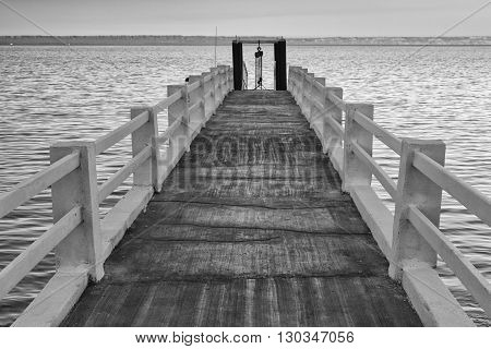 Wooden Platform On The Sea In B&w