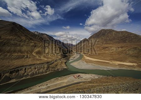 Top view of confluence of rivers Indus and Zanskar looks enticing from hill road going towards Nemo village.