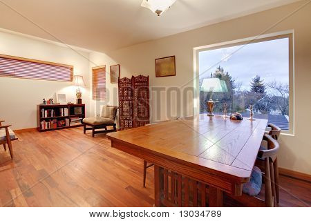 Room With Large Wood Table And Reading Area
