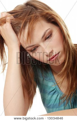 Young beautiful woman in depression, isolated on white