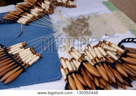 Bobbin coils and handmade lace - close-up