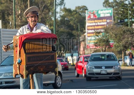 Mexico City, Mexico - February, 9  2015 - Poor Man Playing Hand Organ On The Street