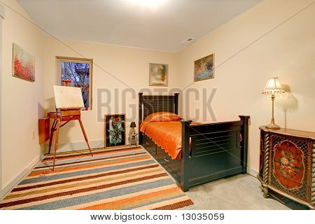 Guest Bedroom With Small Black Bed
