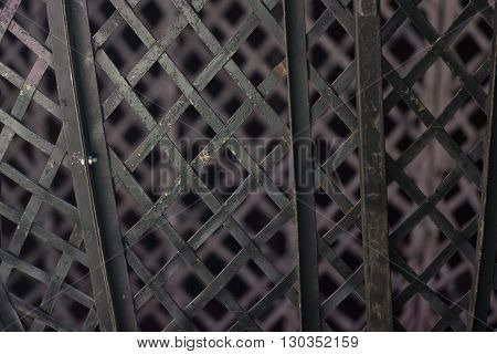 metallic grill background on brown detail close