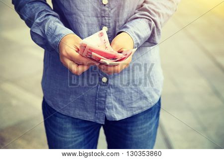 closeup of people hands counting money on street