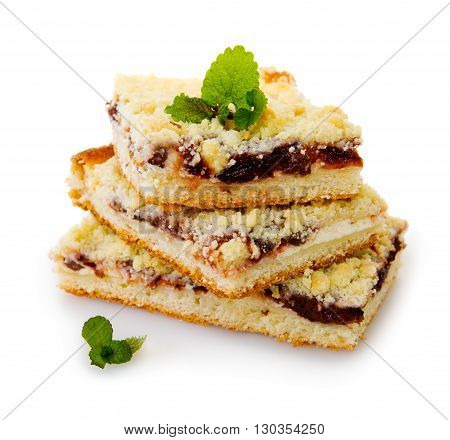 Crumble cake with plum isolated on  white background.
