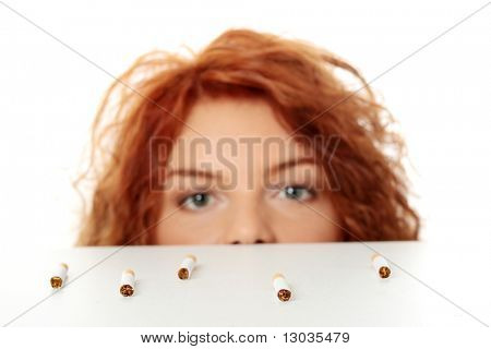Stop Smoking concept, isolated on white background. Focus on cigarette