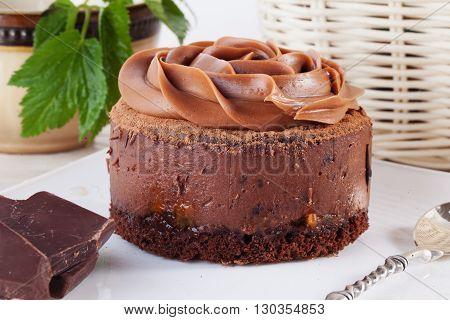 Rose chocolate mousse cake on a beautiful plate closeup cream