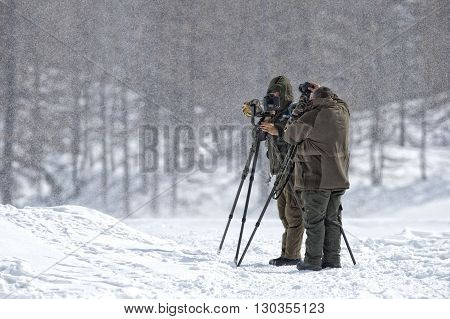 Photographers Under The Snow Storm In Muntain