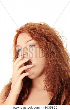 Young woman yawing, isolated on white