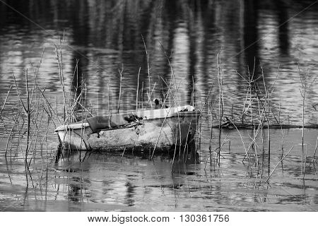 Old Fisherman Boat In A Lake In Winter Time