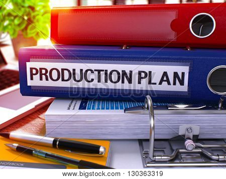 Blue Office Folder with Inscription Production Plan on Office Desktop with Office Supplies and Modern Laptop. Production Plan Business Concept on Blurred Background. Production Plan - Toned Image. 3D.