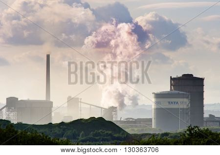 PORT TALBOT WALES UK - MAY 18 2016  Tata Steel production facility at Port Talbot. Troubled steel plant in South Wales releasing steam in evening sun