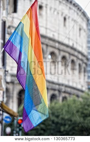 Rainbow Flag On Rome Gay Street Colosseo Background