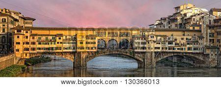 Florence Ponte Vecchio bridge view cityscape at sunset