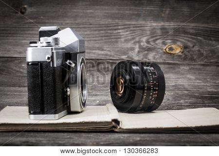 Old Camera At  Vintage Book, Wooden Background