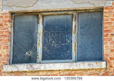 Bullet Holes On Glass Window