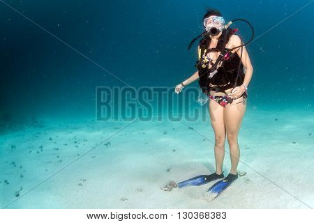 Beaytiful Latina Diver Standing On Sand