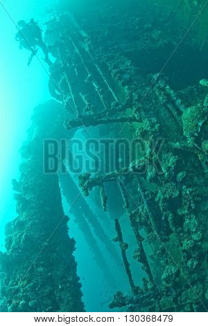 Scuba Divers Exploring A Ship Wreck In Red Sea