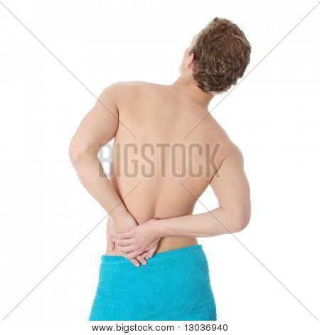 Young man with hands on his back - pain concept
